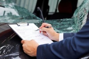 Man filling out a truck accident claim